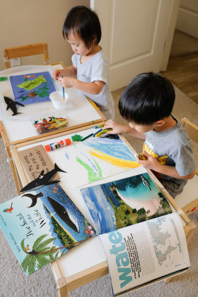 Children working on their art activity inspired by the book The Snail and The Whale