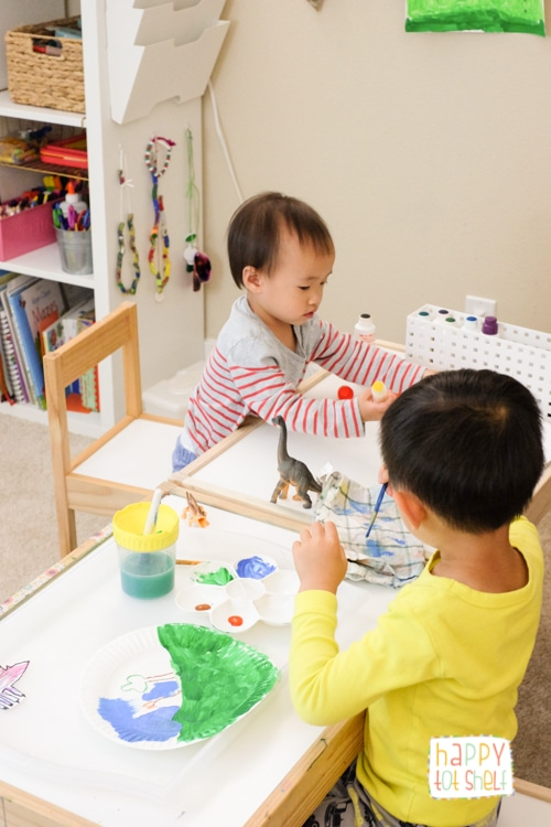 Young children making art in their learning space