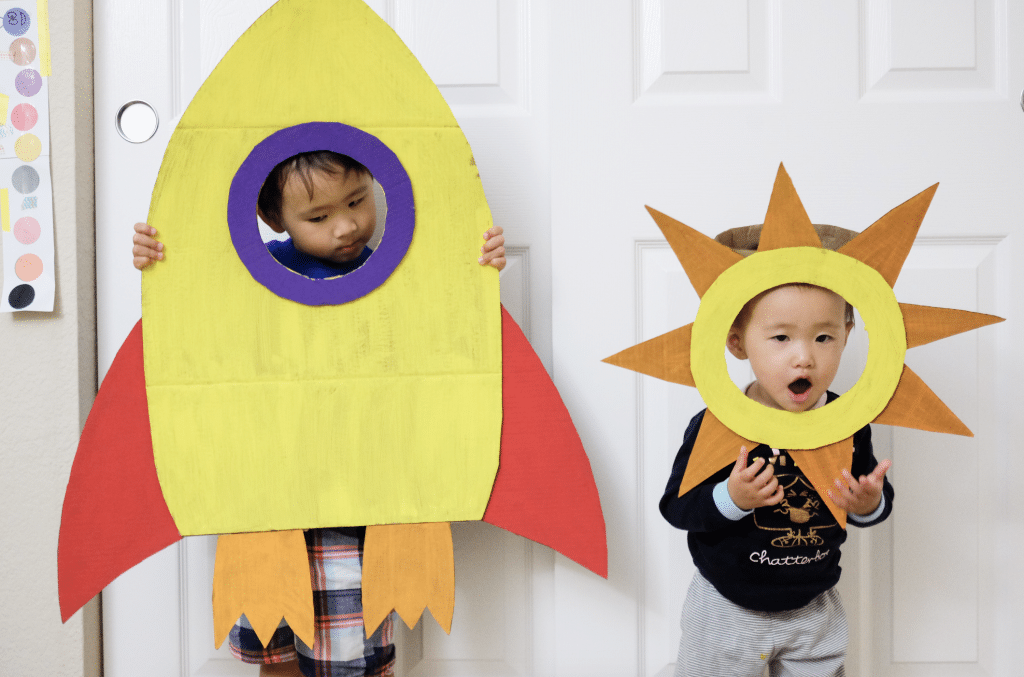Cardboard Rocket and sun halloween costumes