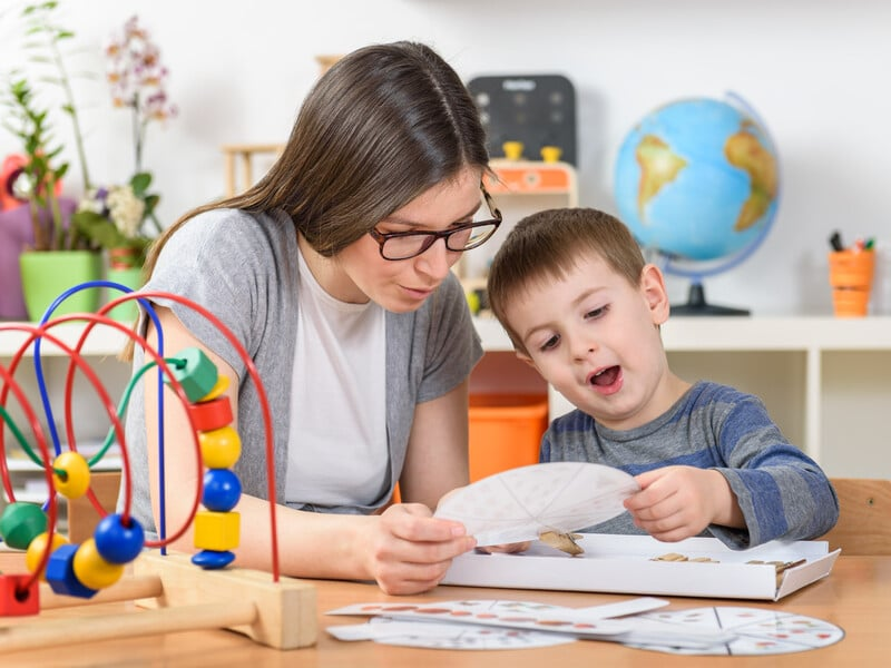 Teacher supports child in learning
