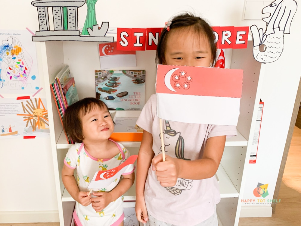 My children waving their Singapore flags proudly